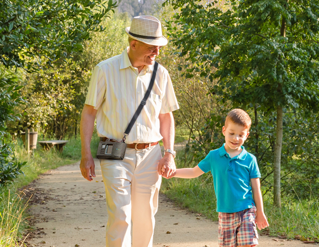 Grandfather wearing LifeVest WCD walking with grandson